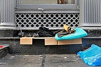 bedding of a homeless person at Financial District, USA, New York City, Manhattan