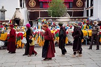 Tibetans circumnambulate the Jokhang Temple along the Barkor a Tibetan Bazaar, China, Tibet, Lhasa