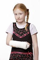 8-year-old girl with her arm in plaster
