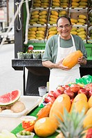 Hispanic man working at fruit stall