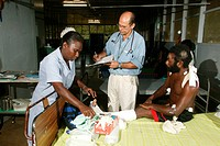 Doctor doing his round in the hospital, Butaweng, Papua New Guinea, Melanesia