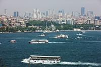 Ferry Boats on the Bosphorus in front of Galata and Kabatas districts and the skyline of Istanbul, Turkey
