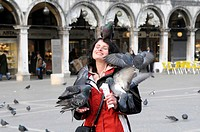 Woman feeding pigeons, Piazza San Marco Square, Venice, Veneto, Italy, Europe