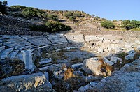 Antique stone amphitheatre of Melos on the Island of Milos, Cyclades Island Group, Greece, Europe