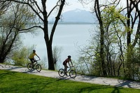 Cyclists at the Chiemsee Lake, Upper Bavaria, Germany, Europe