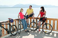 Cyclists having a break at Chiemsee Lake, Upper Bavaria, Germany, Europe