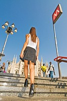 Young woman in Duomo square, Milan, Italy