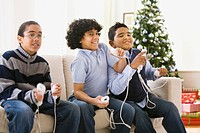 Boys playing video game at Christmas