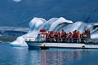Tourist boats between drifting icebergs, Joekulsarlon glacial lagoon, Iceland, Europe