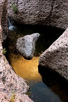 Aravaipa Canyon Wilderness - Boulders in creek showing reflection of cliffs in water - Located about 50 miles northeast of Tucson - Noted for its dese...