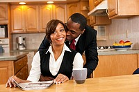 African couple hugging in kitchen