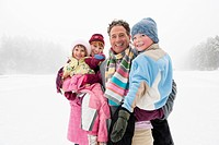 Italy, South Tyrol, Seiseralm, Family on frozen lake, portrait, close_up