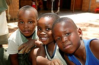 Three boys at a kindergarten, Gaborone, Botswana, Africa