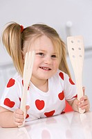 Little girl 3_4 playing with wooden cutlery