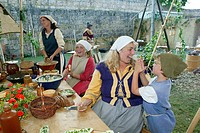 Peasants preparing a meal during a medieval festival, Burghausen, Upper Bavaria, Bavaria, Germany, Europe