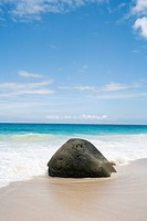 View of single granite boulder on beach, Seychelles