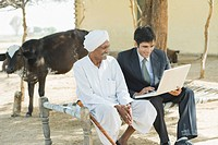 Financial advisor explaining to a farmer about agriculture loan