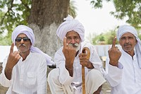 Three farmers showing their fingers with voting marks