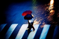 Couple walking in the rain at night  Two people