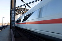 ICE (InterCityExpress) German high-speed train driving over a bridge fast, Hesse, Germany, Europe