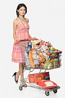 Woman pushing a shopping cart of groceries