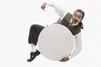 Businessman holding a blank circular placard