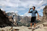Teen drinking water after a long hike on Sentinal Pass, Banff National Park, Canada