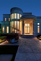Luxury home at dusk with column entry