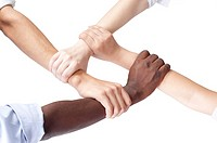 Close_up of different ethnic people's arms holding one another