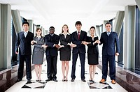 Business people standing in a row and holding hands together (thumbnail)
