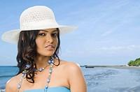 Portrait of a female fashion model posing on the beach