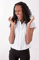 Young woman shouting with eyes closed (thumbnail)