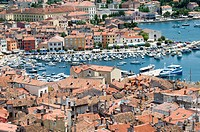 An aerial urban landscape view of the rooftops and harbour in the town of Rovinj, Croatia, showing the crowded conditions Seen from the top of the Cat...