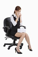 Young office lady sitting on chair and running nose