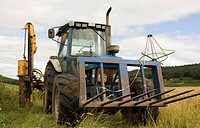 Placing fences with tractor around farming fields at Glen Cat