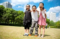 Three children standing in a row with arms around and shouting with mouth open