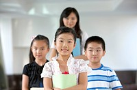 Child, Three children standing with teacher (thumbnail)