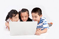 Child, Children lying on front and looking at the laptop together