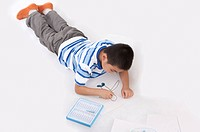 Child, Boy lying on front and drawing