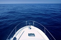 Bow of yacht white boat cruing the blue ocean water in Mediterranean sea