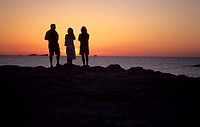 three people standing on the shore watching the sunset, Spain, Balearen, Ibiza