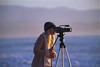 Woman with video camera, Filming, South Africa