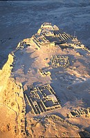Aerial view of ruins of ancient palaces and fortifications on a mountain plateau, former Judean fortress, Masada, at the dead sea, Israel