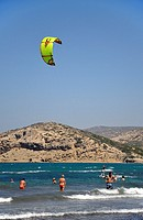 Swimming while watching kite-surfer at Prasonisi, Rhodes island, Greece