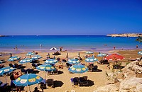 Sunbathers on Coral bay beach, Pafos, South Cyprus