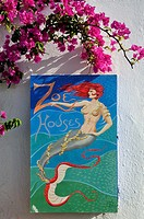 Guest House sign and flowers at Ia village, Santorini island, Greece