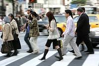 Pedestrians on a crosswalk in Ginza Tokyo Japan