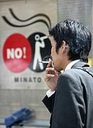 JPN, Japan, Tokyo: Smoker in Tokyo, official smoking area