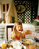 Girl having breakfast on the balcony, Rowendale Homestead, Okains Bay, Banks Peninsula, South Island, New Zealand