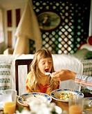 Girl having breakfast on the balcony, Rowendale Homestead, Okains Bay, Banks Peninsula, South Island, New Zealand